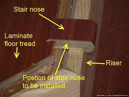 installing laminate flooring on angled stairs position the stair nose on the riser so it