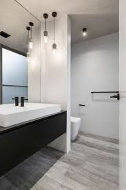 cabinet gtgt. This Mostly White Bathroom With A Black Vanity, Has Simple Pendant Lights\u2026 Cabinet Gtgt N