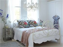 shabby chic bedroom white wrought iron panel bed frame queen crystal glass candle chandelier lighting fixture plank wooden flooring small nighstands 3