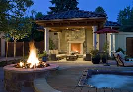 outdoor lighting for pergola with natural fireplace and round fire pit around small swimming pool using chaise lounge chairs with arms under umbrella