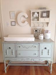 vintage changing station with a wall cabinet for storage