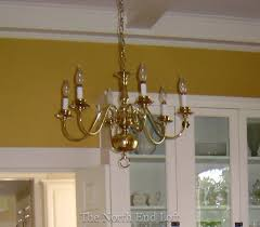spray painting a 1990 s brass chandelier