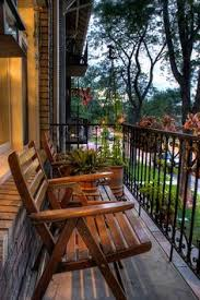 small balcony furniture ideas shady street side balcony the furniture can double to be used in ad small furniture ideas pursue