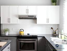 painted kitchen cabinets benjamin moore chelsea gray gray owl white subway tile black laminate countertop budget friendly kylie m interiors e design
