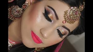 real bride enement nikaah asian bridal makeup gold smokey eyes and bright pink lipstick