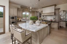 coastal light fixtures wooden cabinets glass windows white marble countertop built in shelves brown island traditional