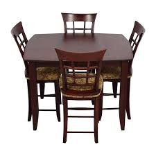 high top dining table with four chairs