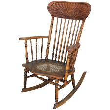 early 20th century press back adirondack rocking chair