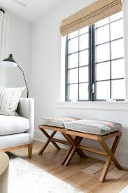 Bright, eclectic living room with black windows in Benjamin Moore's Black  Iron, and a