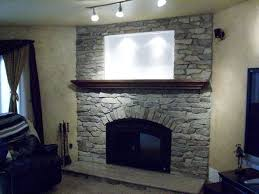 upgraded to new firebox w wrought iron arch face quarry stone wall granite hearth lighted