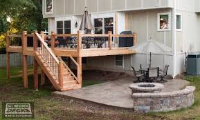 cedar deck and stamped concrete patio