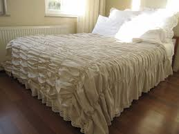 cream ruched duvet cover with wainscoting and wooden floor for bedroom decoration ideas