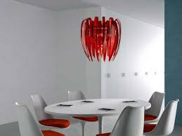 foxy modern light fixtures with red chandelier on plain ceiling above round table closed simple chair plus black book and white color wall