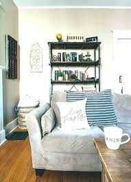 shelf behind couch shelves over couch shelves over couch couch shelf couch and shelf 6 behind