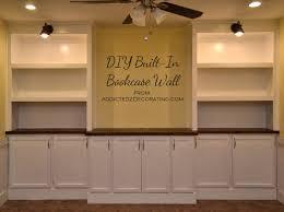 my diy built in bookshelves wall is