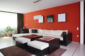 red and black furniture. modern room with red accent wall black furniture and white cushions
