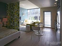 studio living room furniture. this studio apartment features a brightly colored curtain that separates the bedroom area from rest living room furniture r