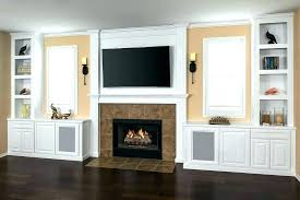 built ins around fireplace in classic white cabinets wall ethanol desk beside with windows w