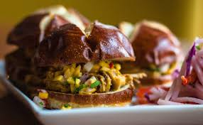 colorful carnitas meat and mango slider sandwiches on brioche buns from the bentwood tavern new buffalo restaurants bentwood tavern from round table pizza