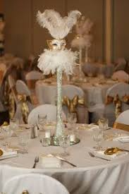 Masquerade Mask Table Decorations like the masks but not a fan of the all white theme The Simple 42