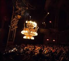 a full house marvels at the world famous chandelier as it ascends over the majestic