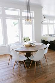 transitional dining chair sch: dining room rustic round wood table surrounded by white eames dining chairs creates an interesting mix in this transitional eat in kitchen