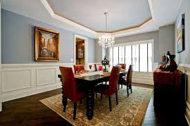 large area rugs with traditional dining room and black dining table sideboard dark hardwood floors glass pendant chandelier red