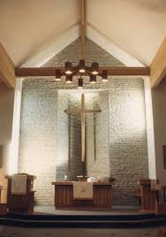 advent lutheran s intimate 300 seat sanctuary is a simple room with a dramatic centre stone wall and skylit wooden cross the roof is supported on two large