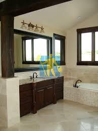 bath restoration brisbane. traditional bathroom with shiny stone tiles and mosaic bath tub sides wooden cabinets brisbane restoration