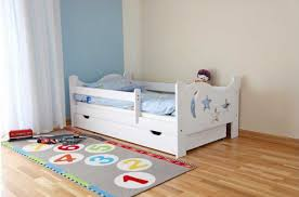 Toddler bed with mattress included with bed rails and drawer