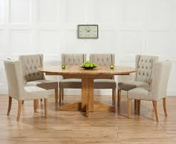 es solid oak 120cm round extending dining set with 4 mille beige chairs