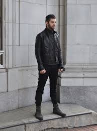 go for a classic style in a black leather er jacket and black wool suit pants