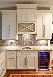 wet bar built of white shaker cabinets with built in wine cooler in base and