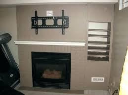how to mount a tv on a brick fireplace above fireplace hiding wires hanging above fireplace how to mount a tv on a brick fireplace