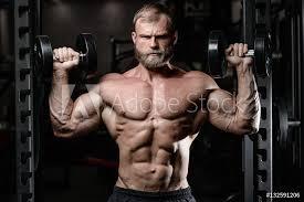 Fotografie Obraz Brutal Muscular Man With Beard Unshaven Fitness