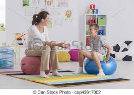 physiothe sitting on gym ball csp43617002