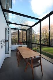 modern sunroom. Contemporary Narrow Sunroom Extension That Features Black Shutters Modern O