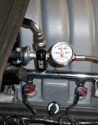 nos progressive controller the rails in this picture not pressure switch or gauge but the rubber tubing going upwards what is this connector called and which is the best way to