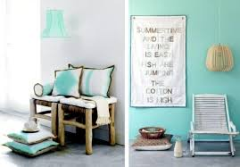 Corresponding design colored walls and pillow Wall color mint green gives  your living room a magical flair