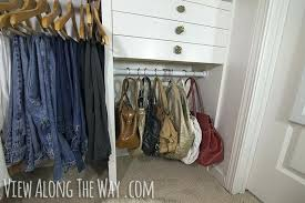 storage for purses in closet garment bag organizing
