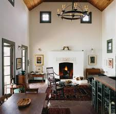 austin texas farmhouse with tufted area rugs living room and wood furniture dark red rug