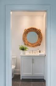 round wood mirror with white shaker