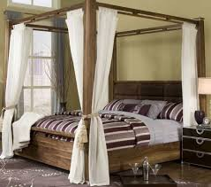 Bedroom With Wooden Canopy Bed Featured White Curtains - Beautiful ...