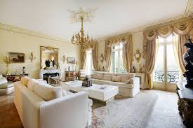 living room with gold color curtains