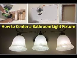how to center a bathroom light fixture with drywall patch