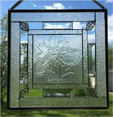 a fused glass center framed by clear glass textures and bevels