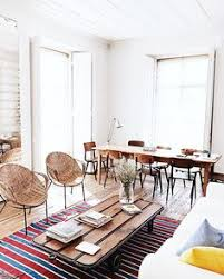 boho minimal interior wooden floors and white walls wicker rattan chairs rustic farmhouse