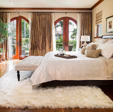 a faux sheepskin rug under the bed may add a touch of er to the flooring