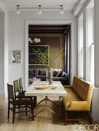 a beautiful mustard velvet bench elevates this dining e