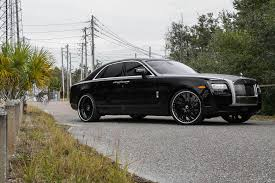 rolls royce ghost 2015 black. this one sitting on a set of canale in black center chrome lip put together by nb customs tampa florida rolls royce ghost 2015